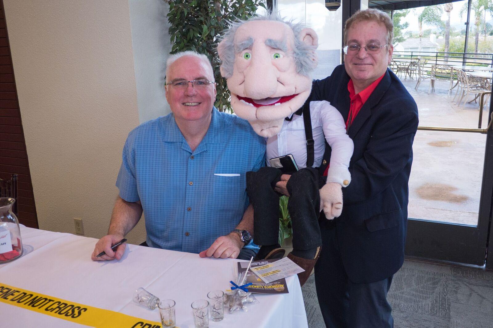 Joe and Arlen Arlington meet David Putnam at the Author's Luncheon
